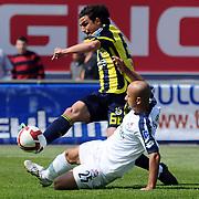 Kasimpasaspor's Mustafa Koray AVCI (F) and Fenerbahce's Mehmet TOPUZ (B) during their Turkish superleague soccer match Kasimpasaspor between Fenerbahce at the Recep Tayyip Erdogan stadium in Istanbul Turkey on Sunday 25 April 2010. Photo by TURKPIX