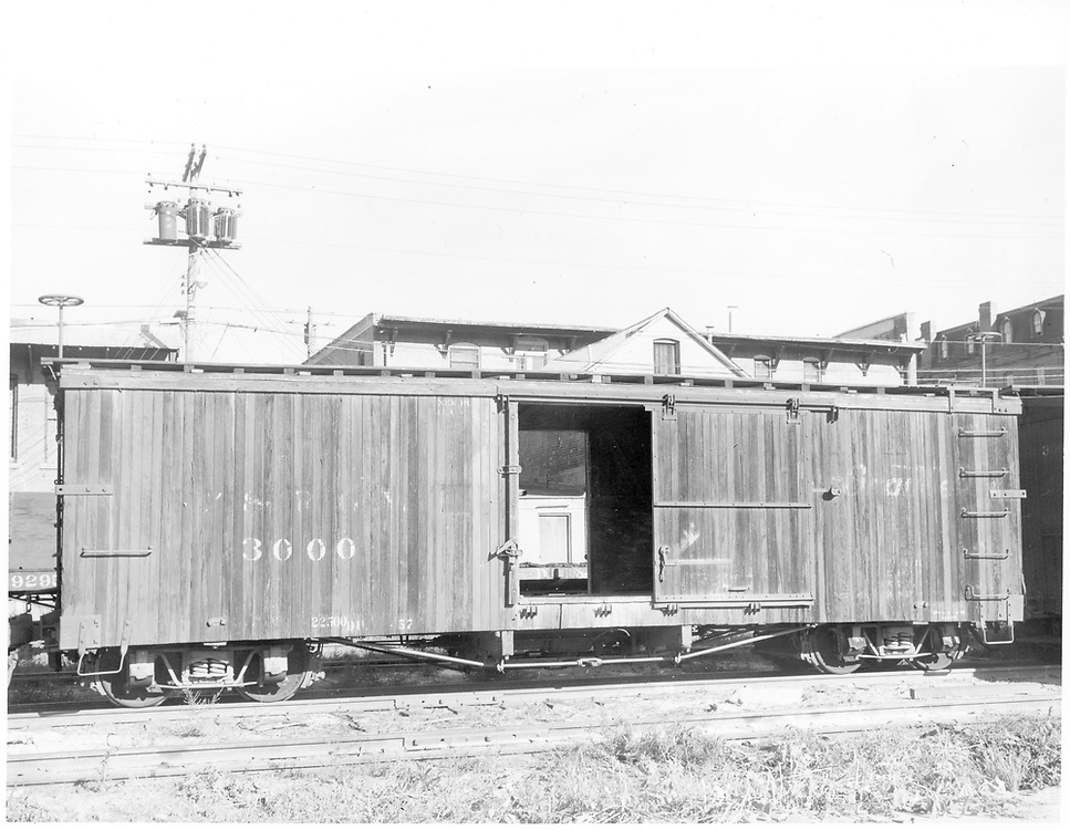 """Side view of box car #3000 at Durango.<br /> D&RGW  Durango, CO  Taken by Payne, Andy M. - 8/30/1959<br /> In book """"Narrow Gauge Pictorial, Vol. III: Gondolas, Boxcars and Flatcars of the D&RGW"""" page 103<br /> Grandt's book attributes a date of 5/5/1970 to this photo."""