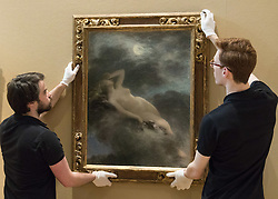 """Bonhams, Mayfair, London, February 26th 2016. Gallery technicians hang """"La Nuit"""" by Henri Fantin-Latour estimated to fetch between £80-120,000 at the Bonhams 19th Century Art Sale in Mayfair, London on March 2nd 2016. ///FOR LICENCING CONTACT: paul@pauldaveycreative.co.uk TEL:+44 (0) 7966 016 296 or +44 (0) 20 8969 6875. ©2015 Paul R Davey. All rights reserved."""