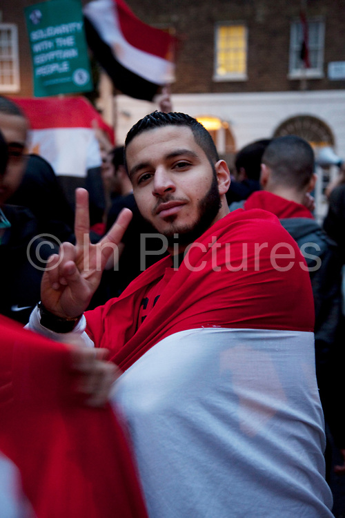 Protesters celebrate at the Egyptian Embassy in London following the announcement in Egypt that President Mubarak will be stepping down from power. The scenes were jubilant.