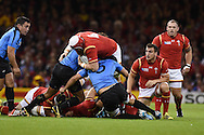 Jake Ball of Wales runs into Jorge Zerbino of Uruguay (5). Rugby World Cup 2015 pool A match, Wales v Uruguay at the Millennium Stadium in Cardiff, South Wales  on Sunday 20th September 2015.<br /> pic by  Andrew Orchard, Andrew Orchard sports photography.