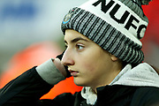A Newcastle United supporter looks on midway through the first half during the Premier League match between Newcastle United and Crystal Palace at St. James's Park, Newcastle, England on 21 December 2019.