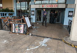 © Licensed to London News Pictures. 17/10/2015. Bristol, UK.  Damage to V Shed following violence between demonstrators and police.  Bristol Patriots vs Anti-Fascists twin demonstrations in Bristol city centre.  The Bristol Patriots were marching against 'Somali rape gangs' and immigration, and the Anti-Fascists opposed them.  Violence flared between Anti-Fascists and police who made several arrests.  Photo credit : Simon Chapman/LNP