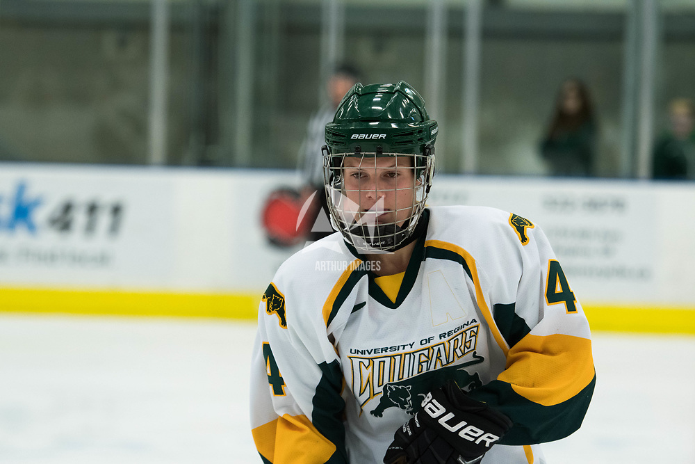 1st year defence man Mackenzie Hutchinson (4) of the Regina Cougars in action during the Women's Hockey Homeopener on October 7 at Co-operators arena. Credit: Arthur Ward/Arthur Images