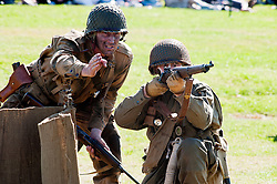 Sunday 18th August 2012 Lytham Saint Annes .Northern World War Two Association (NWW2A)  reenactors portray members of the US 101st Airborne (502nd) Parachute Infantry Regiment attacking German positions during Saturdays Battle reenactment on Lytham Green..18 August 2012.Image © Paul David Drabble