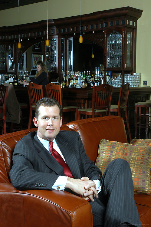 Michael G's, Cincinnati, Ohio: Michael G. Guilfoyle in front of the fireplace at his eatery in Cincinnati, Ohio.