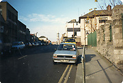 Photo taken circa 1988.<br /> Is this Hill Street or Parnell Place, looking up towards the Temple Street area. If you know why not let us know. Times never change cars still park on double yellow lines.<br /> <br /> <br /> <br /> Old amateur photos of Dublin streets churches, cars, lanes, roads, shops schools, hospitals, Streetscape views are hard to come by while the quality is not always the best in this collection they do capture Dublin streets not often available and have seen a lot of change since photos were taken 1988