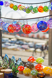United States, Washington, Seattle. Glass ball ornaments and other glass objects for sale at an outdoor market in Seattle