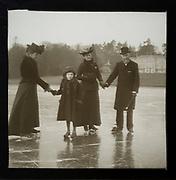 Magic lantern slide well-dressed middle class Edwardian family ice skating England, UK c 1900-1910