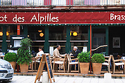 Le Bistrot des Alpilles restaurant. People sitting on the outside terrace eating. Saint Remy de Provence, Bouches du Rhone, France, Europe