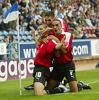 Photo: Aidan Ellis.<br /> Huddersfield Town v Bristol City. Coca Cola League 1. 12/08/2006.<br /> Bristol goal scorer Phil Jevons is mobbed by Scott Murray and Bradley Orr after scoring the first goal