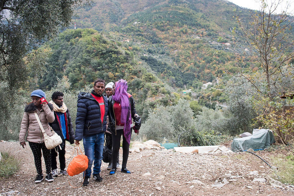 November 9, 2016 - Breil-sur-Roya, France:  Eritrean migrants who  arrived through a  tunnel by foot in the Roya valley from Italy - a 7-hour walk arrive at their temporary shelter with Cédric Herrou. <br /> <br /> 9 novembre 2016 - Breil-sur-Roya, France: Les migrants érythréens qui sont arrivés à pied par un tunnel ferroviaire dans la vallée de la Roya depuis l'Italie - une marche de 7 heures - marchent vers leur abri temporaire chez Cedric Herrou, membre d'un réseau qui aide des migrants.