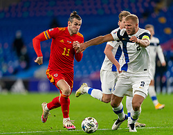 CARDIFF, WALES - Wednesday, November 18, 2020: Wales' captain Gareth Bale (L) and Finland's Paulus Arajuuri during the UEFA Nations League Group Stage League B Group 4 match between Wales and Finland at the Cardiff City Stadium. Wales won 3-1 and finished top of Group 4, winning promotion to League A. (Pic by David Rawcliffe/Propaganda)