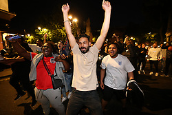 © Licensed to London News Pictures. 07/07/2021. London, UK. England fans celebrating in the streets surrounding Trafalgar Square in central London after England beat Denmark in the Euro 2020 semi final, to reach their first final since 1966. Photo credit: Ben Cawthra/LNP