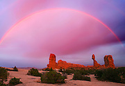 A passing storm brings out a rainbow in Arches National Park, near the geological formation known as Balanced Rock. Colin Braley/Wild West Stock