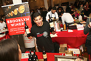 New York, NY - October 30, 2014: A server from Brooklyn Winery presents wine options to guests at Edible Escape, hosted by Edible Manhattan magazine, at the Metropolitan Pavillion in Chelsea. <br /> <br /> CREDIT: Clay Williams for Edible Manhattan<br /> <br /> © Clay Williams / claywilliamsphoto.com