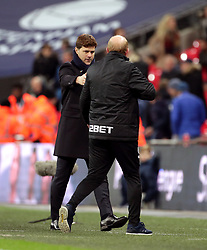 Tottenham Hotspur manager Mauricio Pochettino and West Bromwich Albion caretaker manager Gary Megson (right) shake hands after the Premier League match at Wembley Stadium, London.