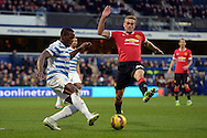 Nedum Onuoha of QPR kicking the ball out past James Wilson of Manchester United. Barclays Premier league match, Queens Park Rangers v Manchester Utd at Loftus Road in London on Saturday 17th Jan 2015. pic by John Patrick Fletcher, Andrew Orchard sports photography.