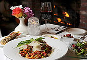 SOUTH YARMOUTH -- 111110 -- Chef Diego Gerardi's Spaghetti Bolognese with a Mushroom Pesto Bruschetta and a Sicilia Caponata salad in front of a glass of Sangiovese wine and the fire place at Gerardi's Cafe.<br /> Cape Cod Times/Christine Hochkeppel 111110ch10