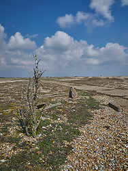 Derelict buildings and industrial detritus litter the site of the former Atomic Weapons Research Establishment on the shingle spit at Orford Ness in Suffolk.