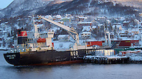 The Cargo Ship NARDJARL Listing While Unloading Containers in Finnsnes Norway. Image taken with a Nikon D2xs and 80-400 mm VR lens (ISO 200, 80 mm, f/4.5, 1/25 sec)