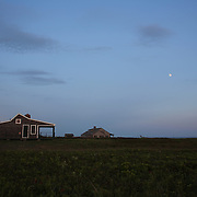 Moon rise over an isolated property on Cisco Beach, Nantucket, Nantucket Island, Massachusetts, USA. Photo Tim Clayton