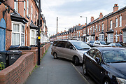 Car parked blocking the pavement in Sparkhill on 24th November 2020 in Birmingham, United Kingdom.  Birmingham has become a city where locals say that there has developed a certain ireesponsibility, where drivers show little respect for the law.