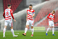 Andrew Butler of Doncaster Rovers (6) winks at Ben Whiteman of Doncaster Rovers (8) before the match during the EFL Sky Bet League 1 match between Doncaster Rovers and Scunthorpe United at the Keepmoat Stadium, Doncaster, England on 15 December 2018.