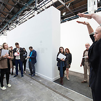 Turner Prize Press Launch, The Tramway, Glasgow, Scotland.<br /> <br /> Curator of Space, Paul Pieroni gives an introduction to Press to the work of Bonnie Camplin.<br /> <br /> <br /> Tramway Glasgow hosts the first ever presentation in Scotland of the Turner Prize – the UK's most prestigious art prize.  The exhibition runs from 1 October 2015 – 5 January 2014.  The winner of Turner Prize 2015 will be announced at an awards ceremony at Tramway on Monday 7 December 2015 and will be broadcast live to the public on Channel 4.<br /> <br /> Picture Drew Farrell tel : 07721-735041<br /> <br /> The short listed artists are Assemble, Bonnie Camplin, Janice Kerbel, Nicole Wermers.<br /> <br /> Image is free to use in ther promotion of The Turner Prize and their partners and stakeholders. For further info : Brian Maycock, Glasgow Life +44 (0)07884 116421  Brian.Maycock@glasgow.gov.uk or Drew Farrell tel : 07721-735041