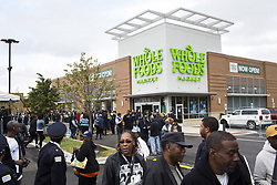 September 28, 2016 - Chicago, IL, USA - Customers gather outside during the grand opening of the Whole Foods Market at the corner of West 63rd Street and South Halsted Street in the Englewood Neighborhood Wednesday, Sept. 28, 2016, in Chicago. (Credit Image: © Armando L. Sanchez/TNS via ZUMA Wire)