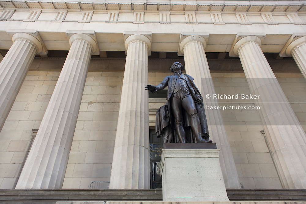 Statue of first President George Washington outside the Federal Hall National Memorial on Wall Street, New York City.