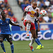 Thierry Henry, (right), New York Red Bulls, in action watched by Shaun Francis, San Jose Earthquakes, during the New York Red Bulls Vs San Jose Earthquakes, Major League Soccer regular season match at Red Bull Arena, Harrison, New Jersey. USA. 19th July 2014. Photo Tim Clayton