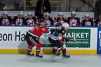 KELOWNA, CANADA - OCTOBER 28: Conner Bruggen-Cate #20 of the Kelowna Rockets stick checks Kody McDonald #26 of the Prince George Cougars on October 28, 2017 at Prospera Place in Kelowna, British Columbia, Canada.  (Photo by Marissa Baecker/Shoot the Breeze)  *** Local Caption ***