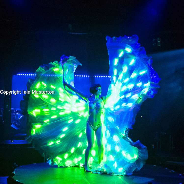 Edinburgh, Scotland, United Kingdom. 21November, 2017. Cabaret group Le Clique present their Christmas show Le Clique Noel at the Spiegeltent in Edinburgh as part of the city's annual Christmas festivities. Vicky Butterfly performs her light dance.
