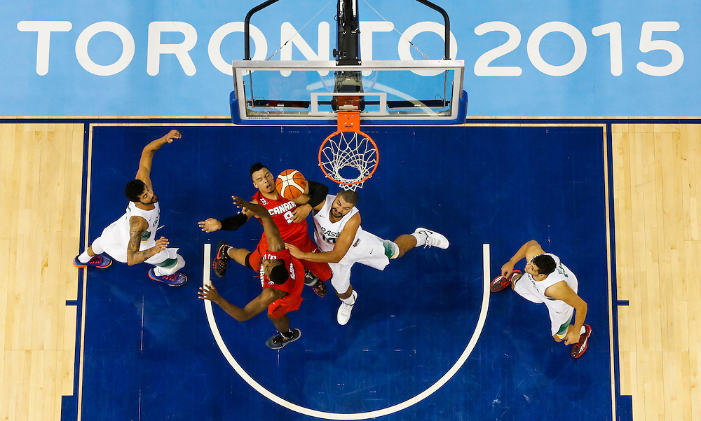 Canada's Dillon Brooks, 9, and Melvin Ejim battle for the ball with Brazil's Carlos Nascimento, centre, during the second half of their gold medal basketball game at the Pan Am Games in Toronto, Saturday July 25, 2015.