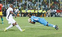 Photo: Steve Bond/Richard Lane Photography.<br />Ghana v Guinea. Africa Cup of Nations. 20/01/2008. Keeper Camara Kemoko saves at the feet of Junior Agogo (L)