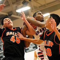 013114  Adron Gardner/Independent<br /> <br /> Grants Pirate Cassius Corley (33), center, ties up with Gallup Bengal Tyler John (45), left, as Bengal Matthew Begay (30) looks on in Grants Friday.