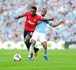 Manchester United's Danny Welbeck jostles for the ball with Manchester City's Fernandinho - Photo mandatory by-line: Dougie Allward/JMP - Tel: Mobile: 07966 386802 22/09/2013 - SPORT - FOOTBALL - City of Manchester Stadium - Manchester - Manchester City V Manchester United - Barclays Premier League