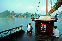 Halong Bay Boat Crew - Crew taking a break on the deck of a junk on Halong Bay enjoying the UNESCO World Heritage views of Halong Bay even though they see these sights every working day, it is hard not to appreciate the scene, even if it is your own back yard.