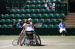 Diede De Groot (left) and Yui Kamiji celebrate winning the Ladies' Wheelchair Doubles Final on day thirteen of the Wimbledon Championships at the All England Lawn Tennis and Croquet Club, Wimbledon. PRESS ASSOCIATION Photo. Picture date: Sunday July 15, 2018. See PA story TENNIS Wimbledon. Photo credit should read: Steven Paston/PA Wire. RESTRICTIONS: Editorial use only. No commercial use without prior written consent of the AELTC. Still image use only - no moving images to emulate broadcast. No superimposing or removal of sponsor/ad logos. Call +44 (0)1158 447447 for further information.
