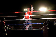"""A victorious Krumper..Battlezone 2005 held at the Great Western Forum in Inglewood, CA. Krumpers and Clown dancers from South Central LA showcase their dancing skills in a yearly competition. Tommy Johnson, aka """"Tommy the Clown"""" started the Clown dance and Krumping movement in South Central LA as a real alternative to gangs and crime. The high energy Krumping and Clown dancing are hip hop based with African tribal dancing tributes. Face paint is often worn to distinguish the dancers unique dance styles, most are clown like with graffiti accents. The dance movement was made popular by the recent documentary """"Rize"""" by photographer David LaChappelle which featured """"Tommy The Clown"""".."""