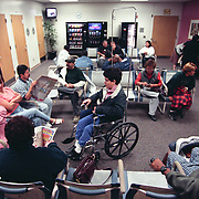 People wait at a crowded emergency room at Riverside County Reginal Medical Center in Moreno Valley, CA east of Los Angeles. Please Contact Me With Licensing Questions or Requests. This image is *not* available for licensing via online. Please contact Todd Bigelow directly with your licensing requests. This image is *not* available for commercial use.