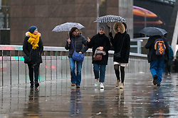 © Licensed to London News Pictures. 01/12/2018. London, UK.  People walking with umbrellas during rain and wet weather, on London Bridge on the first day of meteorological winter.  Photo credit: Vickie Flores/LNP