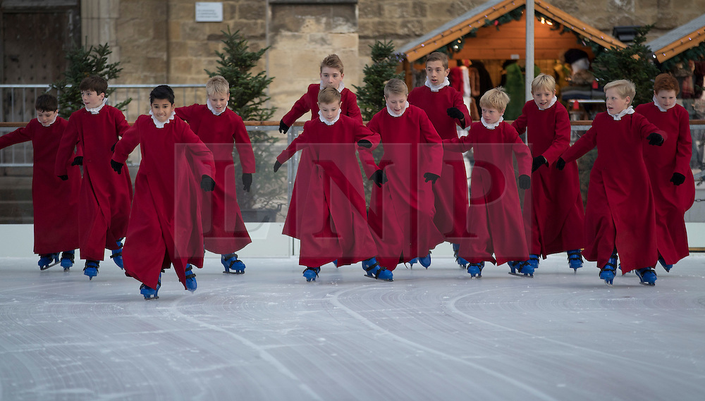 © Licensed to London News Pictures. 18/11/2016. Winchester, UK. The Choristers of Winchester Cathedral try out the seasonal ice rink. Celebrating it's 10th anniversary, the ice rink opens to the public from today until January 2, 2017. Photo credit: Peter Macdiarmid/LNP