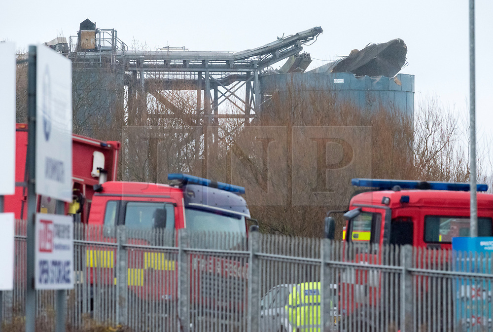 © Licensed to London News Pictures; 03/12/2020; Bristol, UK. Explosion in Avonmouth. A storage tank that appears badly damaged can be seen at the site of an explosion at Kings Weston Lane. There are reports of multiple casualties and emergency services are on the scene. Photo credit: Simon Chapman/LNP.