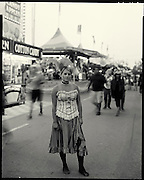 After getting photographed by a new digital camera in a old time costume, Calgarian Mandie Leslie is then photographed by a real old time 8x10 camera. Leslie was taking part in the Stampede for the evening with her husband and son and were getting an old time family photo taken. Photograph by Todd Korol for The Globe and Mail