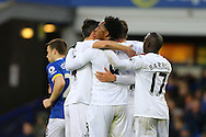 Gylfi Sigudsson of Swansea City (not in view) celebrates with his teammates after scoring his teams 1st goal from the penalty spot. Premier league match, Everton v Swansea city at Goodison Park in Liverpool, Merseyside on Saturday 19th November 2016.<br /> pic by Chris Stading, Andrew Orchard sports photography.