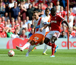 BlackPool's Anthony Mcmahon plays the ball away from Nottingham Forest's Michail Antonio - Photo mandatory by-line: Alex James/JMP - Mobile: 07966 386802 09/08/2014 - SPORT - FOOTBALL - Nottingham - City Ground - Nottingham Forest v Blackpool - Sky Bet Championship - First game of the season