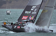 NZL82 powers through the chop on the run tom the start line for race four of the America's Cup 2003. 28/2/2003 (© Chris Cameron 2003)
