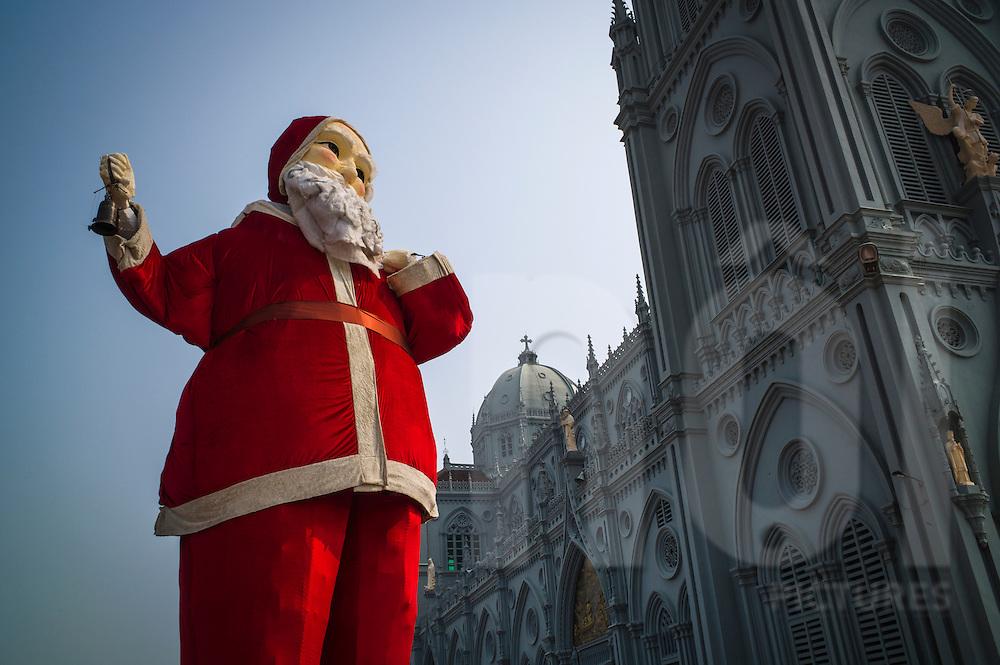 Large Santa Claus figure beside Kien Lao Cathedral, Kien Lao Village, Xuan Tien Commune, Xuan Truong District<br /> , Nam Dinh Province, Vietnam, Southeast Asia
